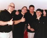 Ninety Eight Degrees Doing Good Sign in Black Shirt