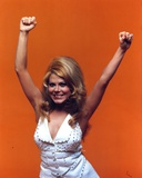 Charo Posed in Orange Background