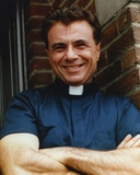 Robert Blake smiling in Priest Shirt