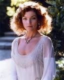 Amy Irving Looking at the Camera wearing a White Dress with a Necklace in Portrait