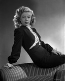 Gloria DeHaven posed On A Chair in Black Formal Dress in Black and White