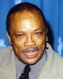 Quincy Jones smiling in Close Up Portrait wearing Gray Formal Suit