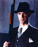 Keith Carradine Posed in Suit With Gun