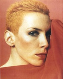 Annie Lennox posed in Close Up in Red Background