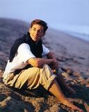 Patrick Dempsey sitting on Mountain