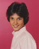 Ralph Macchio smiling in Polo With Red Background