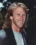 Peter Horton smiling in Close Up Portrait wearing Gray Shirt with Vest