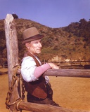 Laramie Cast Leaning on Wood in Cowboy Outfit