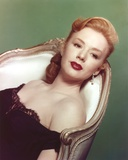 Piper Laurie Lying on Chair wearing Black Dress Portrait