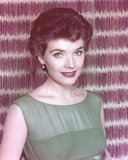 Polly Bergen smiling in Green Dress Portrait