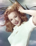 Piper Laurie Posed in a Portrait while Holding Hair in White Sweater