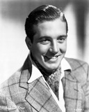 John Payne wearing a Checkered Suit in a Classic Portrait
