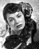 Ruth Roman wearing Black Gown with Huge Earrings
