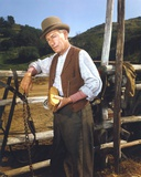 Laramie Cast Member in Cowboy Outfit Holding a Brush