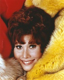 Michele Lee Lying on a Furry Beddings