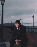 Karl Malden standing in Black Suit