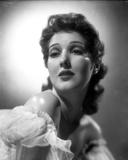 Jean Parker Portrait in White Sheer Ruffled Lace Top Shoulder Dress