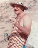 Randy Quaid smiling while Holding Cigar and Beer