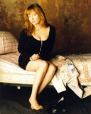 Rebecca Demornay sitting in Bed in Sexy Black Outfit
