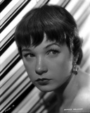 Shirley MacLaine Portrait in White Dress and Pearl Necklace with Eyes Looking to the Left