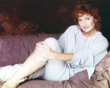 Stephanie Beacham Reclining Pose wearing Blue Dress