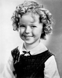 Shirley Temple wearing a White Blouse with a Black Gymslip