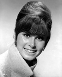 Stefanie Powers smiling in Black and White Close Up Portrait wearing Winter Coat