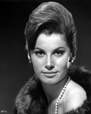 Stefanie Powers smiling in Black and White Close Up Portrait wearing Fur Coat with Pearl Necklace