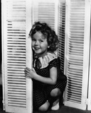 Shirley Temple Leaning on a Blinder in a Classic Portrait