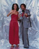 Marilyn McCoo standing in Dress With Man