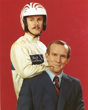 Smothers Brothers One Smoking a Cigar and the Other wearing a Helmet