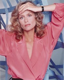 Lauren Hutton Posed in Red Dress