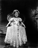 Shirley Temple wearing a White Gown