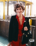 Jessica Walter Portrait in Black Coat and Red Collar Dress with Black Leather Shoulder Bag