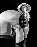Shirley Temple standing in Black Boots