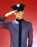Richard Thomas Saluted in Red Background