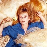 Rebecca Demornay Lying in Blue Polo