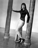 Maria Montez standing in Black and White Dress with Heels