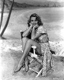 Joan Blondell sitting on an Actor's Chair
