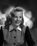 June Allyson Curly Hairdo smiling in Black and White Dress