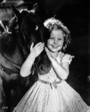 Shirley Temple Playing Horse in Floral Dress
