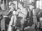 Anatomy Of A Murder Three Men Talking While sitting Outside the Station in Movie Scene in Black and