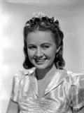 Ann Gillis smiling and wearing a Glossy Blouse Portrait