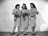 Andrew Sisters standing and Clapping in a Group Picture in Classic