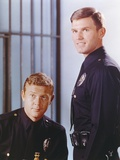 Adam-12 posed with Police Officer Uniform Near a Cell in a Movie Scene