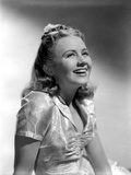 Ann Gillis wearing a Silk Top and smiling in Portrait