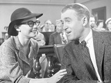 Anatomy Of A Murder Man Talking Happily to a Woman in a Movie Scene in Black and White