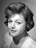 Angela Lansbury smiling and Looking Away wearing a Checkered Dress
