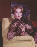 Vera Miles sitting on Couch