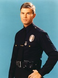 Adam-12 Man in Police Uniform Making Serious Face in Blue Background